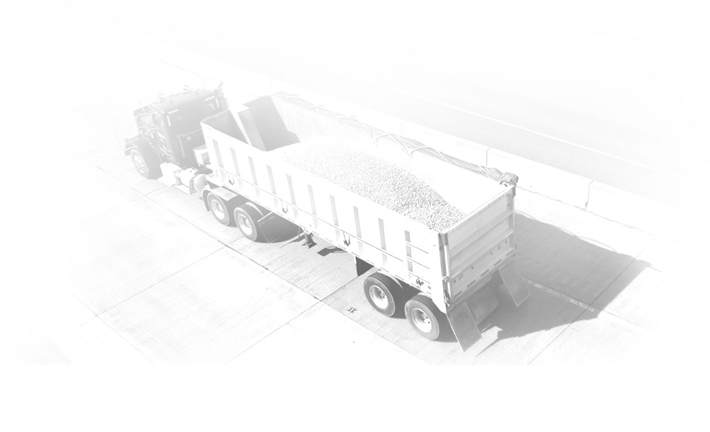 Tractor passing material into a truck